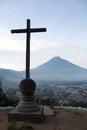 Cross and volcano over Antigua Guatemala valley Royalty Free Stock Photo