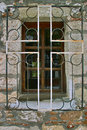 Cross on window fitting the stone greek orthodox church in the form of a Royalty Free Stock Photography