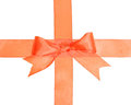 Crossed orange ribbons with bow isolated on white background Royalty Free Stock Images