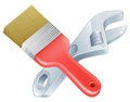 Crossed spanner and paintbrush tools icon of cartoon construction or diy or service concept Royalty Free Stock Photos