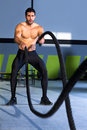Crossfit battling ropes at gym workout exercise Stock Images