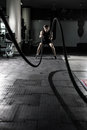 Photo : Crossfit battling ropes at gym workout exercise. Crossfit sporty handsome