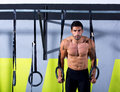 Crossfit dip ring man workout at gym Stock Images