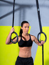 Crossfit dip ring woman relaxed after workout at gym Royalty Free Stock Photo