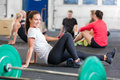 Crossfit exercise for flexibility and mobility smiling women doing using a yoga fitness foam roller Royalty Free Stock Photo