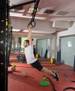 Crossfit fitness dip ring swing exercise man workout at gym Royalty Free Stock Photography