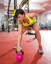 Crossfit fitness kettlebells swing exercise workout at gym woman Stock Photo