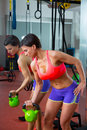 Crossfit fitness lifting kettlebell woman at mirror workout weight exercise gym Royalty Free Stock Photography