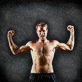 Crossfit fitness man flexing strong on blackboard and aggressive showing muscles background with copy space for text male cross Stock Image