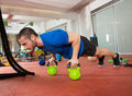 Crossfit fitness man push ups kettlebells pushup exercise at gym workout Royalty Free Stock Photography