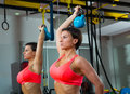 Crossfit fitness weight lifting kettlebell woman at mirror workout exercise gym Royalty Free Stock Images
