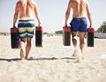 Crossfit games two men running with jerry cans as a part of Stock Image