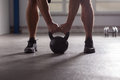 Crossfit - kettlebell training backlit Royalty Free Stock Photo