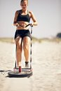 Crossfit sled pull exercise pulling a on sand Stock Photo
