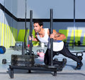 Crossfit sled push man pushing weights workout Royalty Free Stock Photos