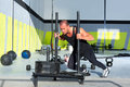 Crossfit sled push man pushing weights workout Stock Photo