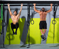 Crossfit toes to bar men pull-ups 2 bars workout Royalty Free Stock Photo