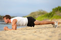 Crossfit training fitness man plank exercise doing core working out his midsection core muscles fit male instructor Royalty Free Stock Image