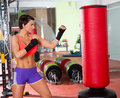 Crossfit woman boxing with red punching bag fitness at gym Royalty Free Stock Photography