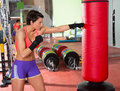 Crossfit woman boxing with red punching bag fitness at gym Royalty Free Stock Photos