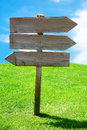 Crossroad wooden directional arrow signs meadow copy space outdoor in the Stock Photo