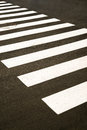 Crosswalk markings painted on the asphalt in the city white paint Royalty Free Stock Photos
