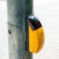 Crosswalk yellow button german version of the cross the street for pedestrians Stock Image