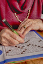 Crossword puzzle - old hands Royalty Free Stock Photo