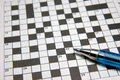 Crossword puzzle & pen Stock Image