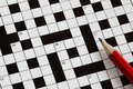 Crossword puzzle solving a with red pencil Stock Image