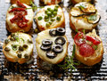Crostini with different toppings on dark background.  Delicious appetizers Royalty Free Stock Photo
