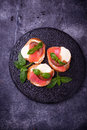 Crostini with salmon, mozarella, tomato and basil Royalty Free Stock Photo