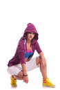 Crouched hip hop woman dancer Stock Photos