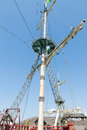Crow s nest on the mainmast of a ship sailing Stock Image