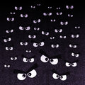 The crowd of angry eyes on a dark background