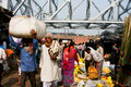 Crowd of asian people rush through the flower market rows in calcutta kolkata india only kolkata s workforce employed primary Royalty Free Stock Photography
