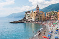 Crowd in the beach of Camogli during a sunny afternoon Royalty Free Stock Photo