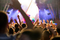 Crowd at concert and blurred stage lights Royalty Free Stock Photo