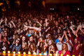 Crowd at a concert surfing during rock show Stock Images