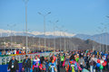 Crowd of fans in sochi russia february the olympic park against snowy mountains warm weather on the coast and the snow Stock Photos