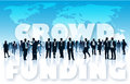 Crowd funding of businesspeople in front of large world map and large words Royalty Free Stock Images