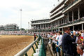Crowd at the kentucky derby view of from track level Royalty Free Stock Images