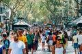 Crowd Of People In Central Barcelona City On La Rambla Street