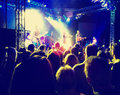 A crowd of people at a concert toned with a retro vintage insta Royalty Free Stock Photo