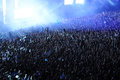 Crowd of people raising their hands at a concert Royalty Free Stock Photo