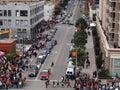 Crowd of people walk along sidewalk towards World Series game