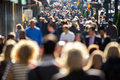 Crowd of people walking on city street anonymous blurred face Stock Photo