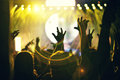 Crowd rocking during a concert with raised arms. Royalty Free Stock Photo