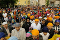 Crowd of sikh devotees take part to baisakhi procession brescia italy april harvest festival on april in brescia Stock Images