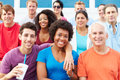 Crowd of spectators watching outdoor sports event smiling to camera Royalty Free Stock Photos